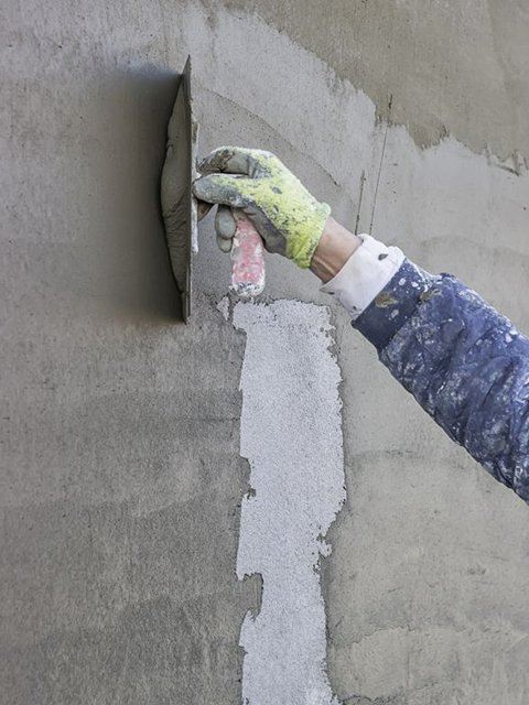 stucco refinishing on exterior wall